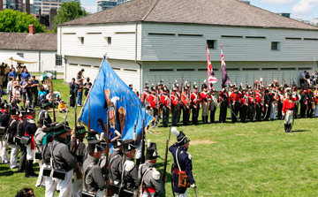U.S. and Crown Forces reenactment units at flag-lowering ceremony during the War of 1812 Festival, Fort York National Historic Site, 15-16 June 2013. Photo: Andrew Stewart.