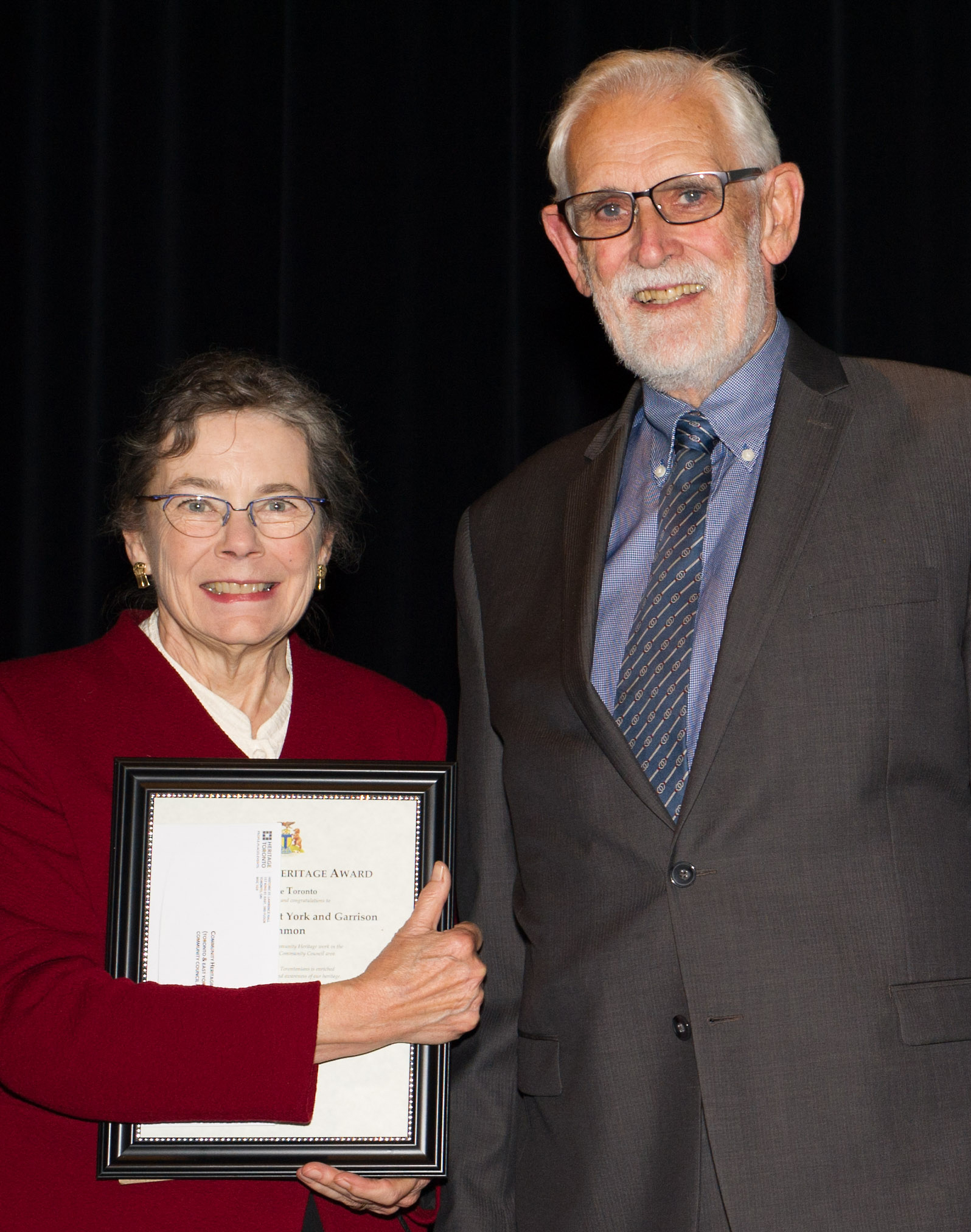 Patricia Fleming, editor of The Fife and Drum, and Joe Gill, past chair of the Friends of Fort York who founded the newsletter in 1998, took to the stage to receive our Community Heritage Award. Credit: Heritage Toronto