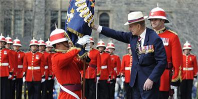 His Royal Highness Prince Philip, The Duke of Edinburgh (HRH), presents new regimental colours to the 3rd Battalion, The Royal Canadian Regiment. Photo: Sergeant Colin Kelley, Royal Canadian Air Force