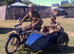 Friends of Fort York guardsman Pierce Cosgrove (left) and Fort York Program Development Officer Kevin Hebib (right), are seen on the 1917 Douglas with sidecar. Beautifully restored in the royal blue colour of The Royal Flying Corps. Photo by Ted Smolak